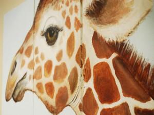 Large giraffe mural on office wall